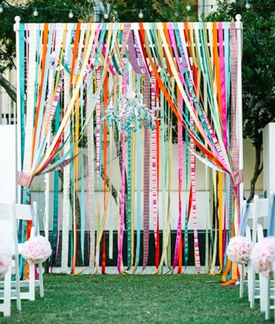 Ceremony backdrop with satin ribbon