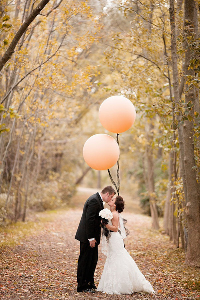 bride and groom with a balloon